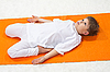 Children`s yoga. The little boy does exercise | Stock Foto