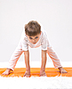 Children`s yoga. Little boy does exercise | Stock Foto