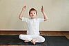Boy does yoga exercise | Stock Foto
