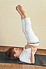 Boy does yoga exercise. Sarvangasana, candle pose | Stock Foto