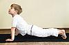 Boy does yoga exercise   Stock Foto