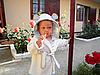 Serious baby in bathrobe in the yard | Stock Foto