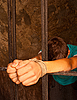 Photo 300 DPI: Man with hands tied with rope behind the bars