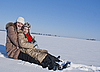 Two happy sisters sledding at winter time | Stock Foto