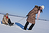 Photo 300 DPI: Two happy sisters sledding at winter time