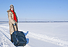 Teen girl with suitcase outdoors at winter time | Stock Foto