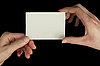 Hands holding white card | Stock Foto