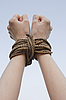 Tied with rope hands | Stock Foto