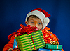 Photo 300 DPI: Surprised boy with Christmas gifts