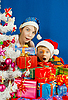 Two surprised kids with Christmas gifts | Stock Foto