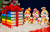 Colorful books and three snowmen | Stock Foto