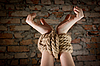 Hands tied up with rope | Stock Foto