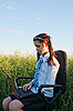 Photo 300 DPI: Teen girl sitting with laptop at field
