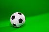 Soccer ball over green | Stock Foto