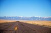 Empty freeway approaching mountains range | Stock Foto