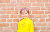 Child near brick wall | Stock Foto