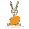Vector clipart: Cartoon funny Easter rabbit with egg