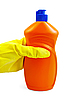 Orange bottle in yellow-gloved hand | Stock Foto