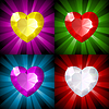 Vector clipart: Sparkling background with jewel heart in four colors