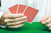 Фото 300 DPI: Игрок `руку карт
