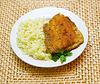 Fried tilapia with rice garnish   Stock Foto