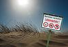 Photo 300 DPI: Danger sign on the dunes