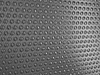 Carbon fibre surface with round shapes | Stock Illustration