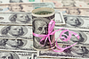100 US dollar wrapped by ribbon on money background | 写真