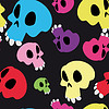 Human skulls on black, seamless