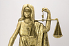 Photo 300 DPI: A lady justice statue over white