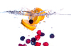 Fresh Fruit Falls under Water with Splash | Stock Foto
