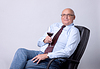 Portrait of successful senior man with glass of wine | Stock Foto
