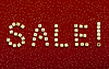 Word SALE of beads on red velvet with sequins | Stock Foto