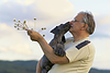Photo 300 DPI: Old man with puppy of Great dane