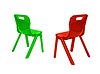 Red and green plastic chairs | Stock Foto