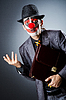 Businessman with clown wig and face paint | Stock Foto