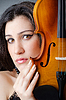 Female violin player against background | Stock Foto