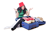 Girl packing for travel vacation | Stock Foto