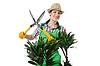 Photo 300 DPI: Woman gardener trimming plans