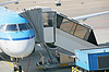 Airplane at an airport with passenger gangway | Stock Foto