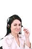 Auricular. El servicio al cliente del operador con un audífono mujer | Foto de stock