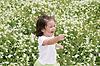 Baby girl happy in garden of flowers   Stock Foto
