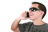 Young casual man talking on phone backgrou | Stock Foto