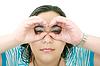 Photo 300 DPI: Young woman looking through imaginary binocular