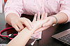 Photo 300 DPI: a health nurse`s hands taking patient`s pulse. Doct