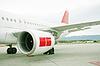 Photo 300 DPI: engine of passenger airplane waiting in airport