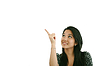 幸福微笑的年轻商业女性显示空白区域 | 免版税照片