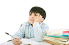Photo 300 DPI: Upset schoolboy doing homework
