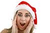 산타 모자에있는 여자가 크리스마스에 깜짝 | Stock Foto