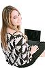 ID 3361417 | Happy young woman using laptop while sittingg on floor | Foto stockowe wysokiej rozdzielczości | KLIPARTO